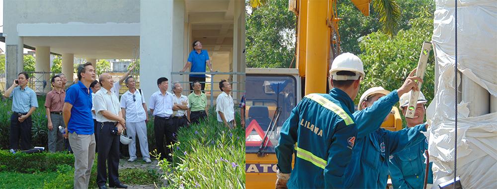 Đoàn CSV, Cán bộ Nhà trường đang theo dõi chi tiết quá trình dựng Tháp-bỏ tấm áo choàng bên ngoài thân tháp